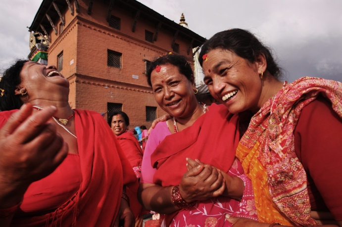 Nepalese women on a pilgrimage to Nepal's most sacred temple (The Monkey Temple) enjoy a joyous moment.